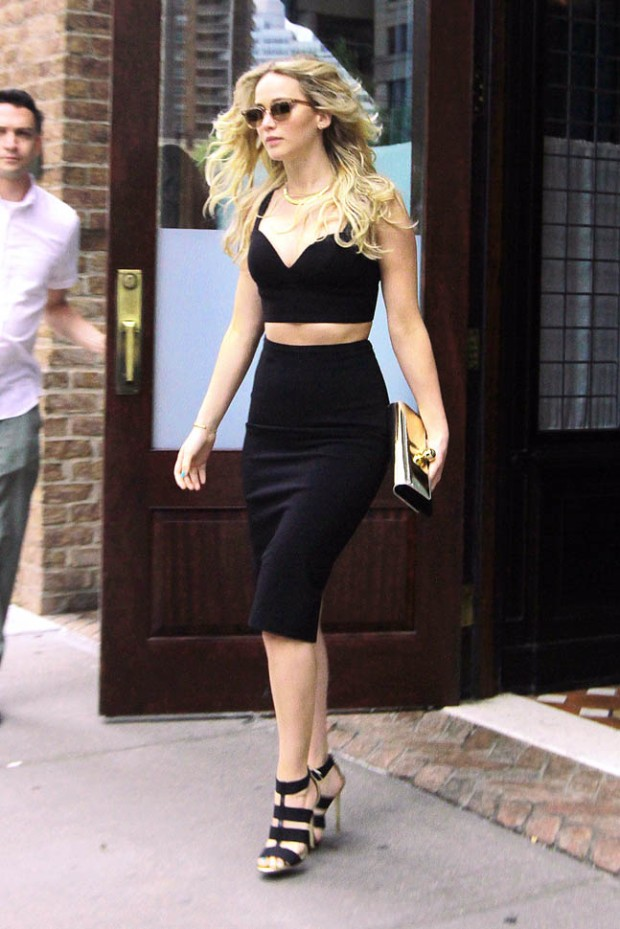 Jennifer Lawrence shows off her midriff in a crop top and pencil skirt while out in NYC.